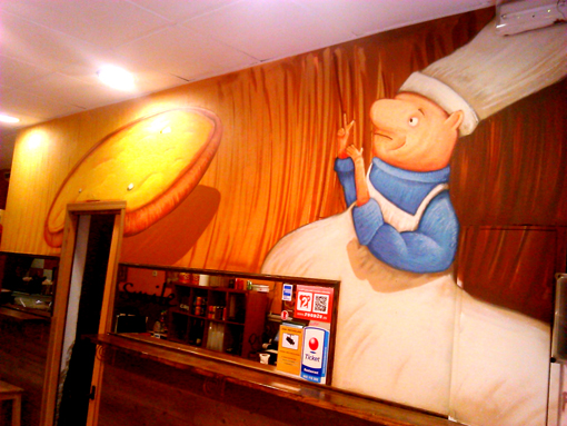 mural en una pizzeria del raval
